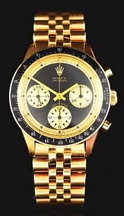 1969 Rolex Daytona Ref. 6241 Paul Newman in 18K Gold.