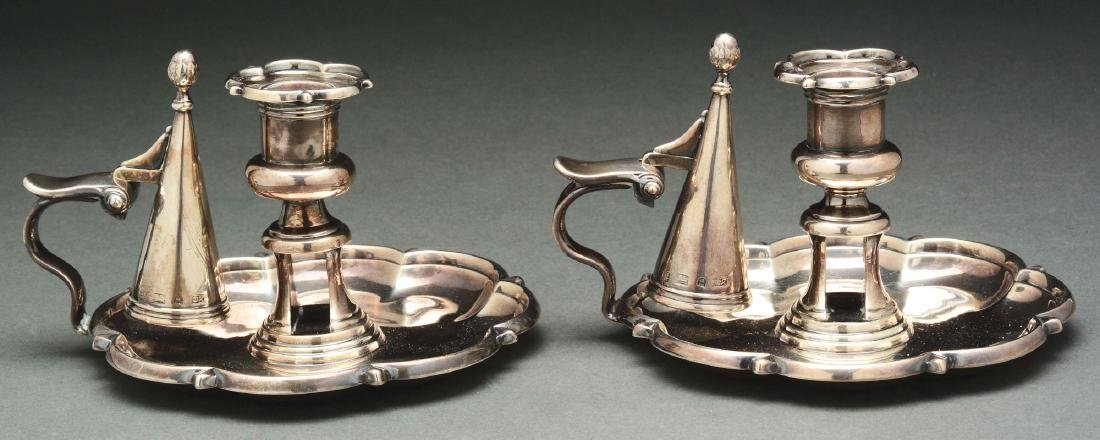A Pair of English Silver Chambersticks.
