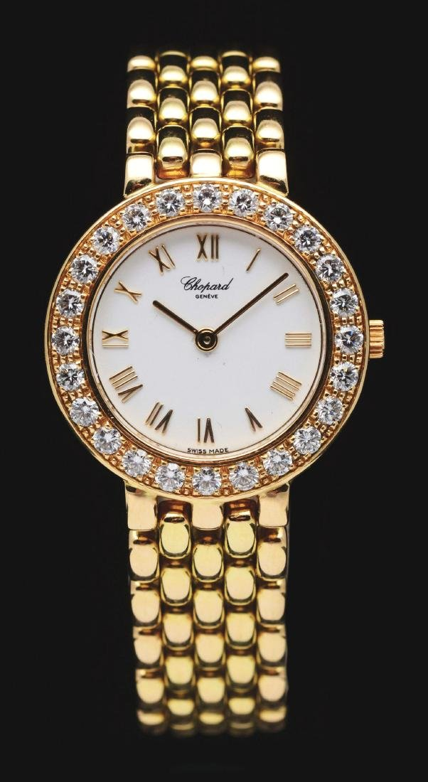Ladies 18K Gold Chopard Diamond Wrist Watch.