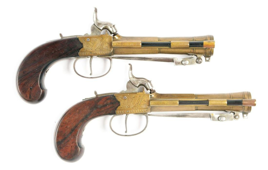 (A) LOT OF TWO: A PAIR OF ENGLISH BRASS BARRELED