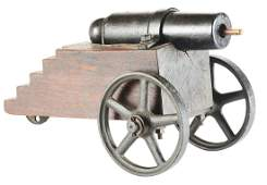 IRON CANNON ON LAYERED WOOD CARRIAGE AND CAST IRON