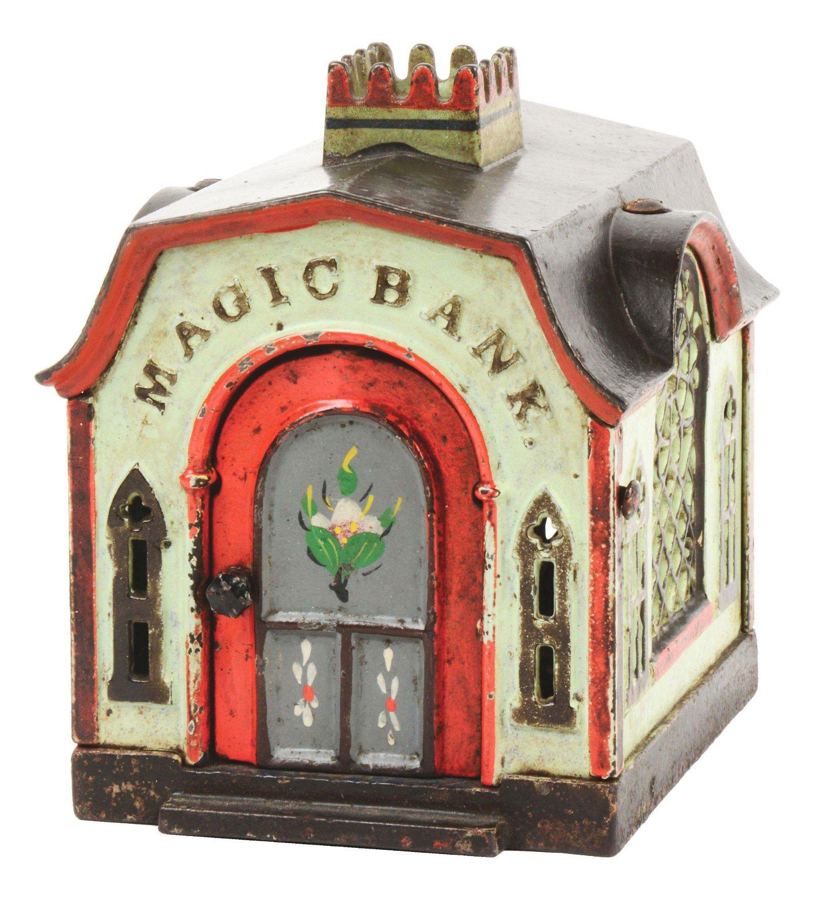 J & E STEVENS MAGIC CAST IRON MECHANICAL BANK.