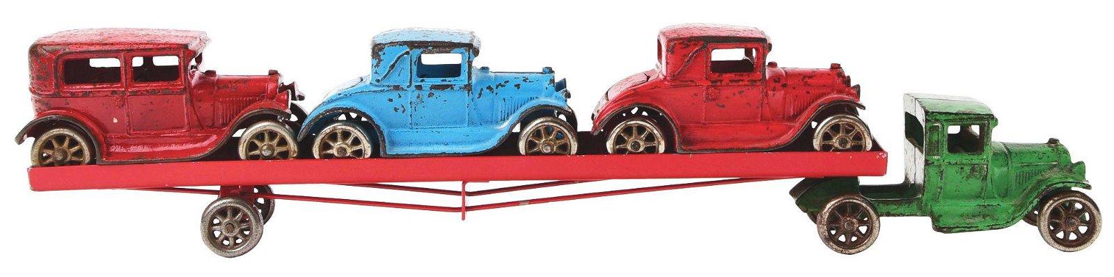 ARCADE CAR HAULER WITH THREE VEHICLES.