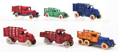 LOT OF 6 CASTIRON AMERICAN MADE STAKE BACK TRUCKS