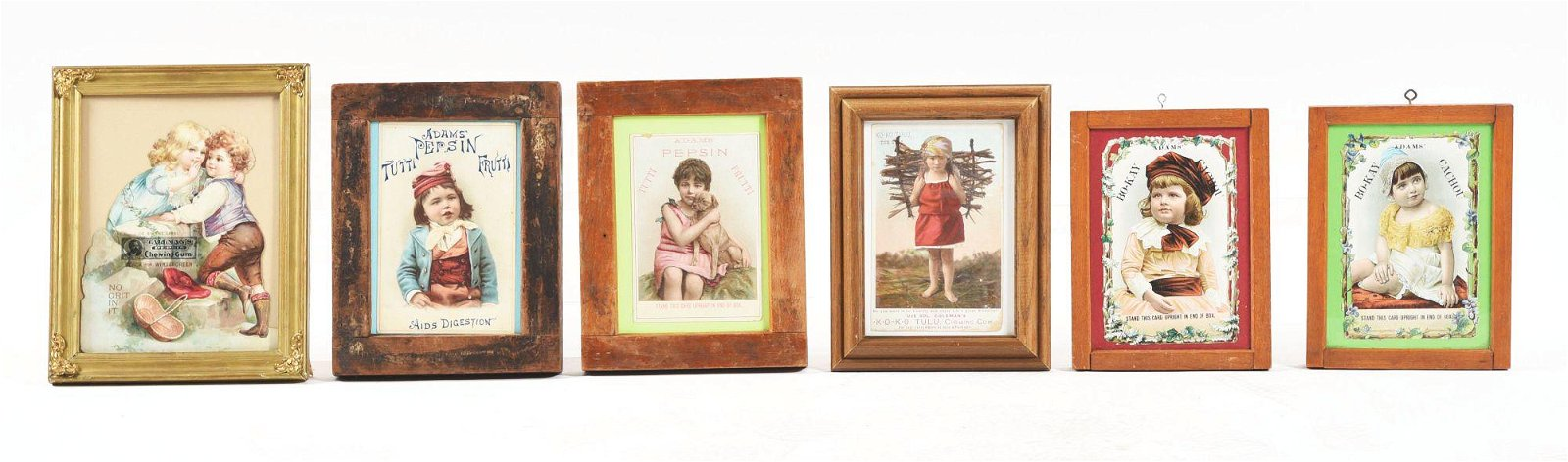 LOT OF 6: FRAMED GUM TRADE CARDS AND ADVERTISEMENTS.