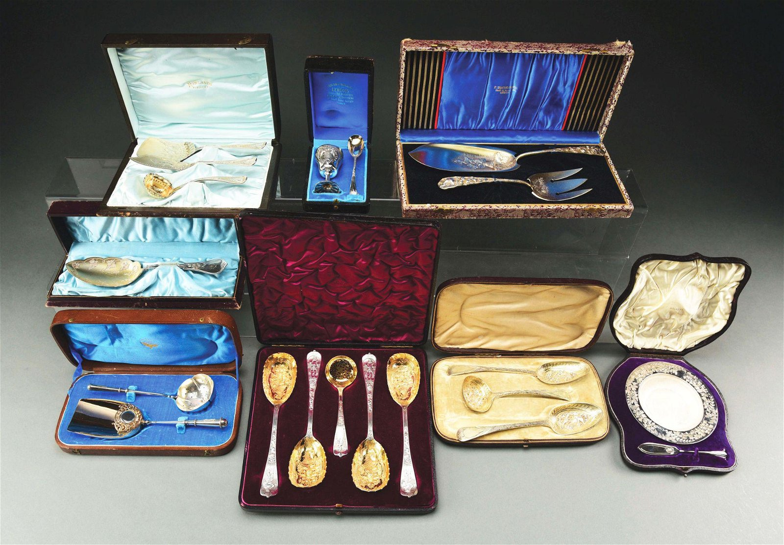A GROUP OF CASED SILVER SETS.