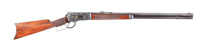(C) WINCHESTER MODEL 1886 LEVER ACTION RIFLE.