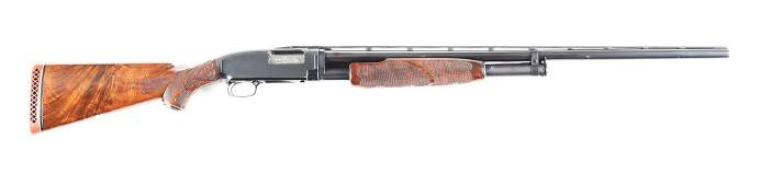 (C) WINCHESTER MODEL 12 SLIDE ACTION SHOTGUN.