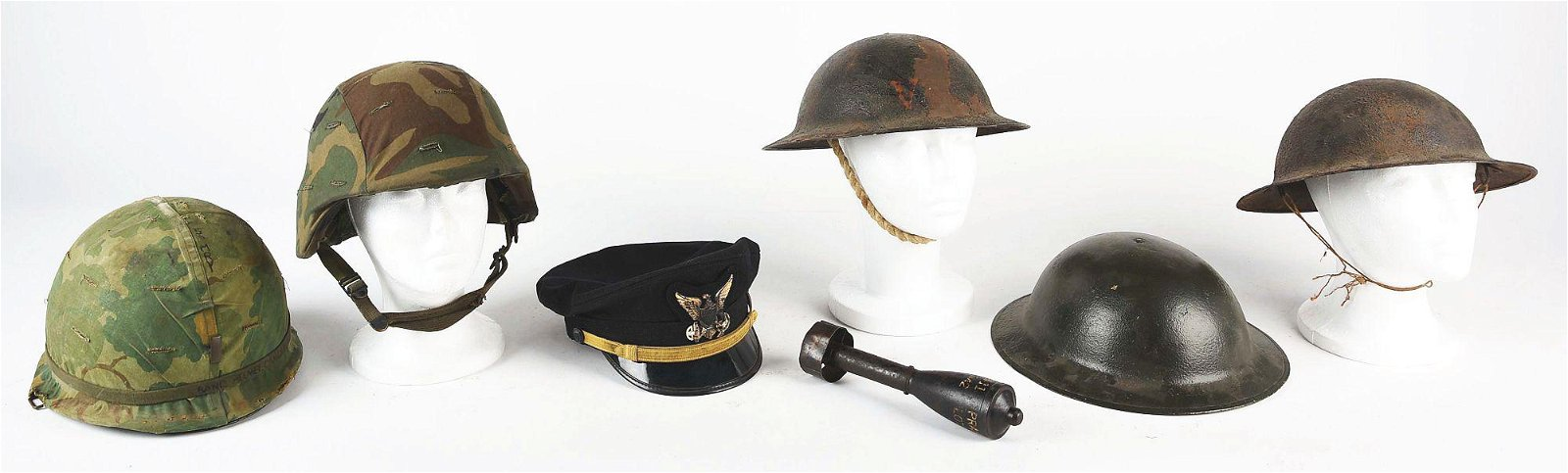 LOT OF SEVEN: US MILITARY HELMETS HAT AND PRACTICE