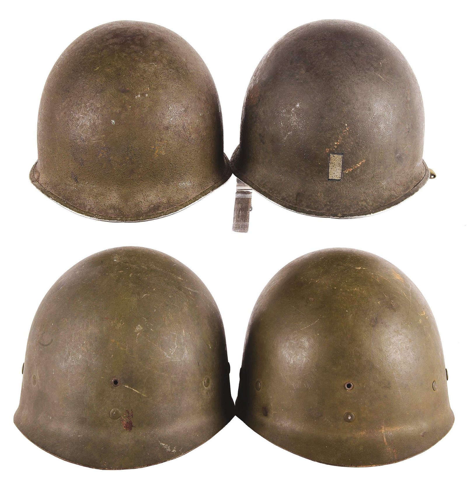 LOT OF FOUR: TWO WORLD WAR II M1 HELMETS WITH LINERS