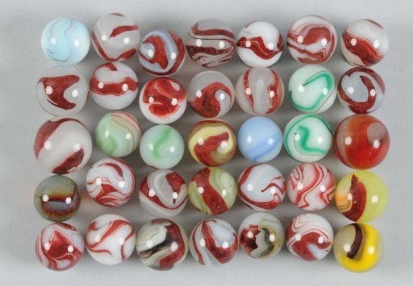 906: Assortment of Oxblood Marbles.