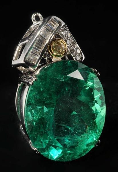 1072: Emerald & Diamond Pendant Set in 18K White Gold.