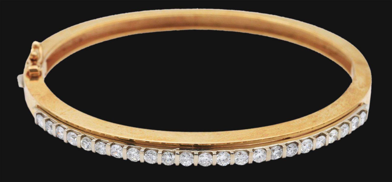 14K GOLD TWO TONE DIAMOND BANGLE BRACELET.