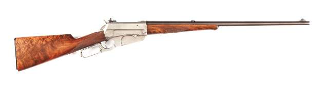 (C) WINCHESTER MODEL 1895 DELUXE LEVER ACTION RIFLE.