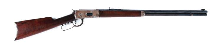 (C) WINCHESTER MODEL 1894 LEVER ACTION RIFLE.