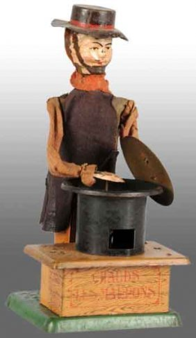 921: French Martin Hand-Painted Chestnut Vendor Toy.