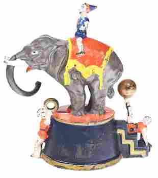 ELEPHANT AND THREE CLOWNS MECHANICAL BANK.