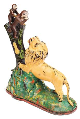 LION AND TWO MONKEYS MECHANICAL BANK.