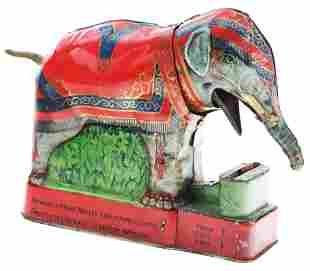ROYAL TRICK ELEPHANT TIN MECHANICAL BANK.