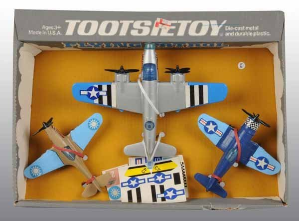 2114: Lot of 3: Tootsie Toy Airplane & Rocket Sets.