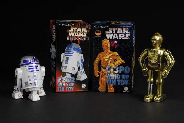 714: Lot of 2: Tin Star Wars C-3PO & R2-D2 Toys.