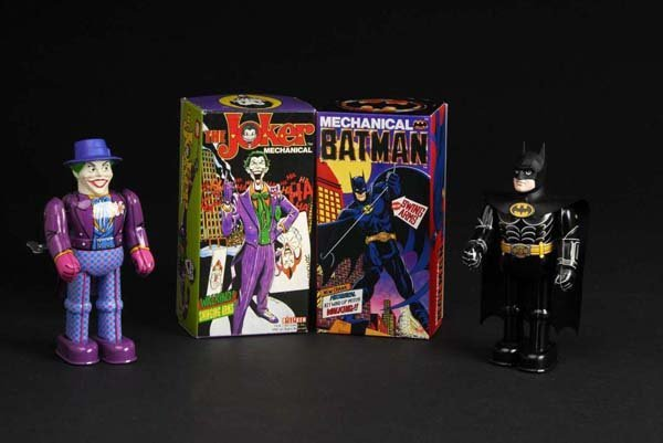 715: Lot of 2: Tin Joker & Batman Wind-Up Toys.