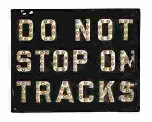 DO NOT STOP ON TRACKS.