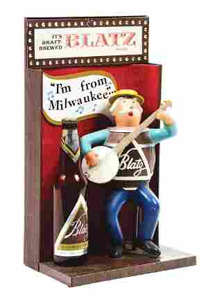 BLATZ BEER BANJO PLAYER ADVERTISING DISPLAY.