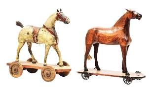 LOT OF 2: CARVED WOODEN HORSES ON WHEELS.