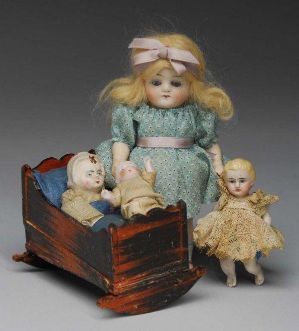 1005: Papier-Mache Squeak Toy and 3 All-Bisque Dolls.