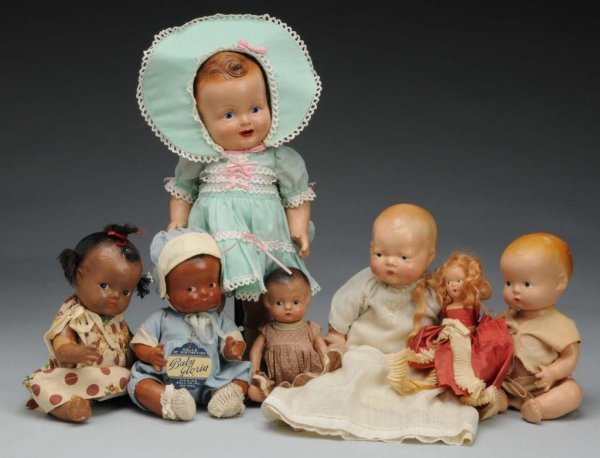 1008: Lot of 7: Composition Dolls.