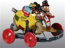 1864: Tin Barney Google & Spark Plug Racing Toy.