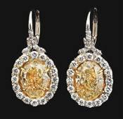 PLATINUM NATURAL FANCY YELLOW 6.37CT DIAMOND EARRINGS
