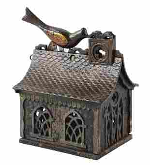 BIRD ON ROOF MECHANICAL BANK.