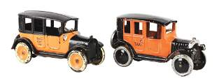LOT OF 2: CAST IRON AMERICAN MADE YELLOW TAXI TOYS.