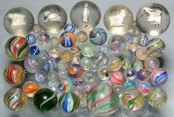 1202: Lot of 71: Handmade Marbles.
