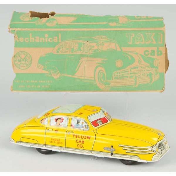 17: Tin Marx Yellow Cab Wind-Up Toy.
