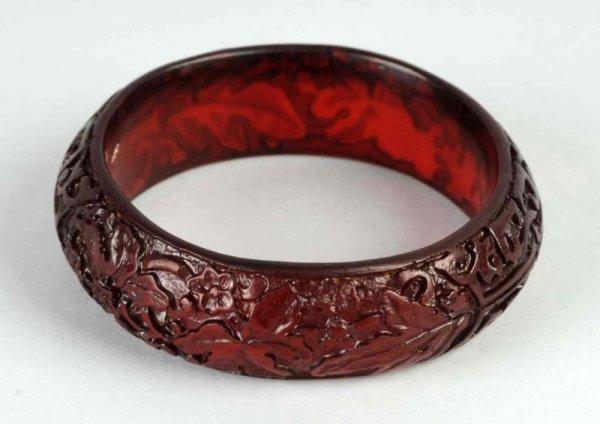 7: Bakelite Carved Red Translucent Bangle.