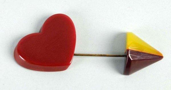10: Bakelite Heart & Arrow Pin.
