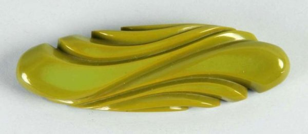 11: Bakelite Carved Green Bar Pin.