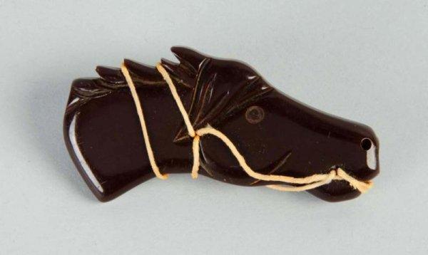 12: Bakelite Carved Brown Horse Pin.
