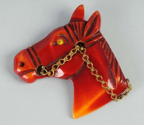 13: Bakelite Carved Red Horse Pin.