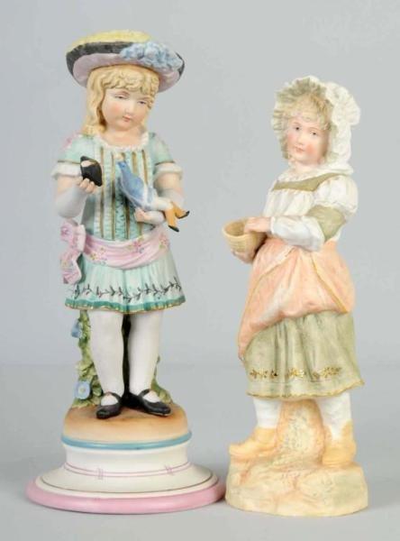 23: Lot of 2: Bisque Figurines.