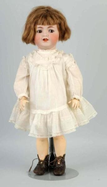 211: German Bisque Character Toddler Doll.