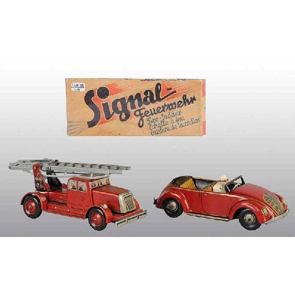 22: Lot of 2: Tin Vehicle Wind-Up Toys.