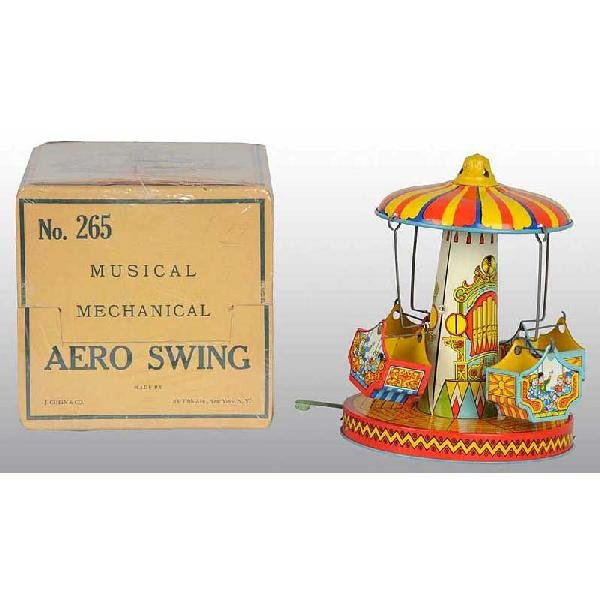 703: Tin Chein Musical Aero Swing Wind-Up Toy.