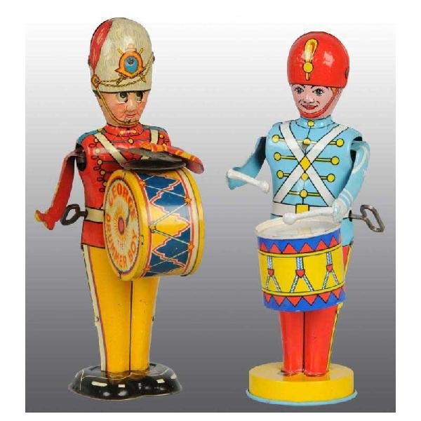 716: Lot of 2: Tin Drumming Wind-Up Toys.