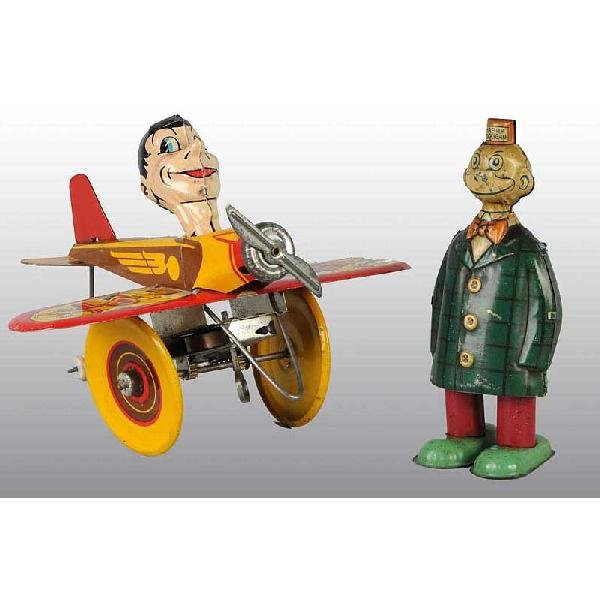 718: Lot of 2: Tin Character Wind-Up Toys.
