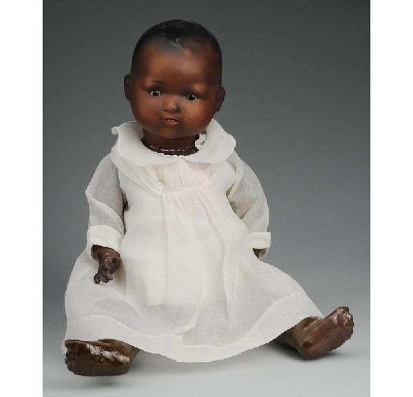 8: Black German Bisque Character Baby Doll.