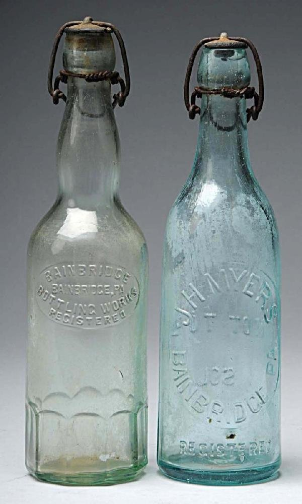 13: Lot of 2: Brewery Bottles.
